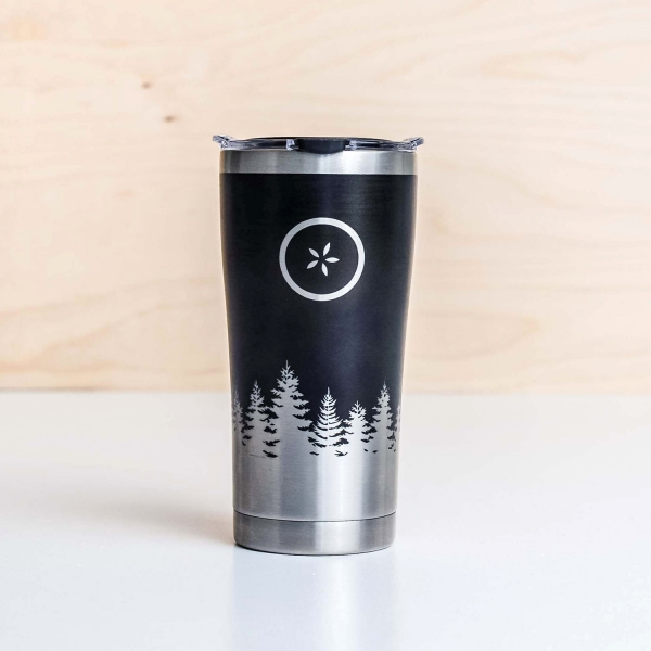 Stainless steel travel mug with a black Michigan Pines design and Johnny's Markets logo on a white tabletop.