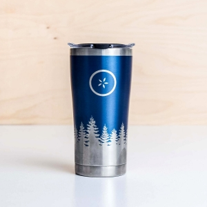 Stainless steel travel mug with a blue Michigan Pines design and Johnny's Markets logo on a white tabletop.
