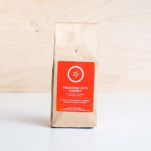 Bag of Johnny's Markets Traverse City Cherry coffee on a white tabletop.